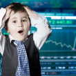 Surprised businessman child in suit with funny face, stock marke — Stock Photo