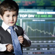 Child dressed businessman with funny face. stock market — Стоковая фотография