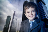 Child dressed businessman smiling — Stock Photo