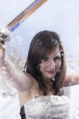 Brunette with samurai sword in the snow — Stock Photo