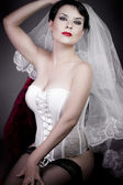 Beautiful bride with veil and white corset, underwear — Stock Photo