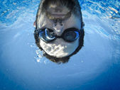 Man face swimming underwater in the pool — Stock Photo