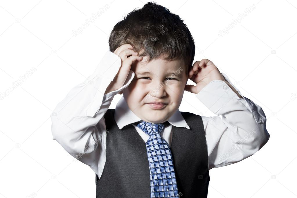 Child dressed like businessman with hands on his face funny — Stock Photo #13177926