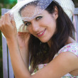 Stock Photo: Beautiful young brunette in a summer garden with white hat