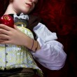 Stock Photo: Young womwith red apple in poetic representation