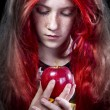 Girl with red apple in a poetic representation - Stock Photo