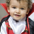 Beautiful blond boy dressed with vampire curls - Stock Photo