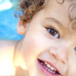 Beautiful blond boy with curls at the pool — Stock Photo #14942491