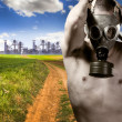 Stock Photo: Environment concept, urbland and nude mwith gas mask