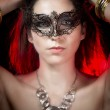 Closeup portrait of sexy woman in red party light, venetian mask — Stock Photo #14944401
