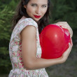 Valentine's Day. Beautiful smiling woman with a gift in the form - Stock Photo