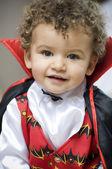 Beautiful blond boy dressed with vampire curls — Stock Photo