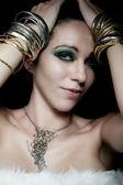 Foto van mooie vrouw met armbanden — Stockfoto