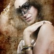 Sensuality brunette with venetian mask, fantasy and romantic con — Stock Photo #18928295