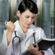 Medical doctor woman in the office, diagnosis concept - Stock Photo
