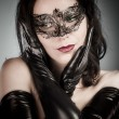 Royalty-Free Stock Photo: Venetian Mask. A pretty retro girl in black wearing a cute hat a