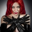 Red hair sexy woman with latex gloves — Stock Photo #18929193
