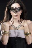 Brunette with venetian mask. Jewelry and Beauty. fashion photo — Stock Photo