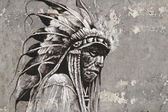 Portrait of native american indian head over textured wall — ストック写真