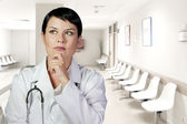 Thinking medical doctor thinking looking up smiling, Medical wom — Stock Photo