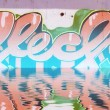 Abstract colorful graffiti reflection in the water, artistic let - Stock Photo