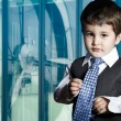 Child dressed businessman with funny face — Stock Photo