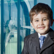 Child dressed businessman with funny face. smiling — Stock Photo
