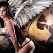 Beautiful young woman with white wings against graffiti backgrou — Stock Photo