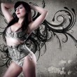 Sexy gril with grey lingerie over tattoo background - Stock Photo