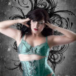 Sexy woman with green lingerie over artistic background — Stock Photo