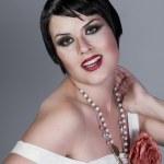 Vintage twenties woman wearing a flapper dress — Stock Photo #21624337