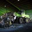 Recycle, overview of refuse collection with bulldozer - Stock Photo