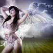 Picture a beautiful angel flying girl in pink lingerie - Stock Photo