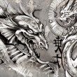 Dragons, tattoo illustration over grey wall - Stock Photo