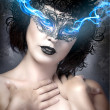 Woman with electric eyes, blue gas coming out of the eyes - Stock Photo