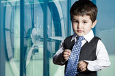 Child dressed businessman with funny face — Foto Stock