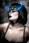 Beautiful woman with short hair and Venetian mask, gas electric — Stock Photo