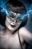 Mysterious brunette woman in lingerie, blue smoke coming out of — Stock Photo