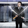 Businessman with two Japanese swords — Stock Photo #21932649