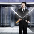 Businessman with two Japanese swords — Stock Photo