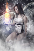 Angel with white wings woman holding a fireball over vintage bac — Stock Photo