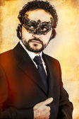 Mysterious man with Venetian mask — Stock Photo