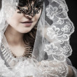Virgin, Woman in veil and black dress with venetian mask — Stock Photo