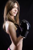 Young woman with boxing gloves — Stock Photo