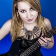 Beautiful young blonde playing electric guitar — Stock Photo