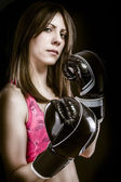Boxing woman, pretty young boxing and defending by hands black — Stock Photo