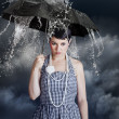 Woman with black umbrella in heavy rain — Stock Photo