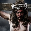 Jesus Christ with crown of thorns white on the cross of Calvary — Stock Photo