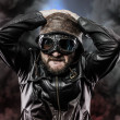 Pilot with glasses and vintage hat over background explosion — ストック写真