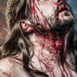 Royalty-Free Stock Photo: Calvary jesus, man bleeding, representation of passion with blue